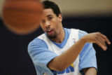 Denver Nuggets Andre Miller passes the ball during practice at the Pepsi Center in Denver on...