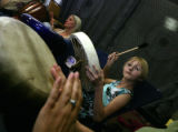 Katya Carlson, (cq) 10 of Lakewood, drums as part of the circle with Eileen Moore Koenigsberg (cq)...