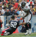 JOE276 - Denver Broncos Brandon Marshal, #15, slips past  Buffalo Bills John Di Giorgio, #52, in...