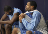 (DENVER, Colo., April 21, 2005)  Denver Nugget, Marcus Camby (right)  ices his thigh as he watches...