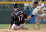 Colorado Rockies' first basemen Todd Helton beats San Diego's Marcus Giles tag as he slides for a...