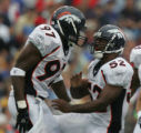 JOE1162 - Denver Broncos Simeon Rice, left, and Ian Gold celebrate in the third quarter against...