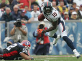 JOE277 - Denver Broncos Brandon Marshal, #15, slips past  Buffalo Bills John Di Giorgio, #52, in...