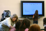 MJM2169  Fourth grad teacher, Bev Walker (cq) talks to a student as her class learns to use a...