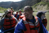 DLM1006  Lee Tom Jones, 25, center, smiles from ear to ear as he floats down the Colorado River...