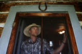 MJM931  Freddie Botur (cq), who oversees Cottonwood Ranches outside of Daniel, Wyoming poses for a...