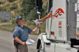 Colorado State Trooper  Ryan Byers (cq)  of the Motor Carrier Safety Unit advise truckers of a new...