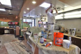 Mike Lopez (cq) paints above the front counter at Jack In The Box  now under construction in...