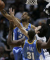 Denver Nuggets Marcus Camby, #23, swats the ball from  San Antonio Spurs Manu Ginobili, right, as...