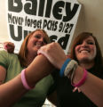 Waitresses Melissa Camp (cq) 17,  left, and Devon Dey (cq) 17, wear bracelets in memory of their...