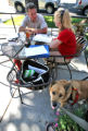 Willoughby (cq) a husky mix, age 7, enjoys the outdoor patio at Racines with his owner Lisa...