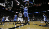Denver Nuggets Marcus Camby, #23, pulls down a rebound  against the San Antonio Spurs Robert...