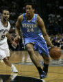 Denver Nuggets Andre Miller, right, drives past San Antonio  Spurs Tony Parker, #9,  in the second...