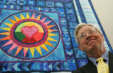 Jim Walpole (cq), superintendent of Platte Canyon School District, stands in front of a quilt for...