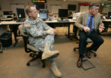 0026 Colonel Hans Kallam, CQ, State Emergency Management Chief, left, and Mason Whitney, CQ,...