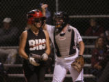 Catcher for Cherokee Trail , Christina Blanton signals to her pitcher after a strike out in the...