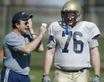SPECIAL TO THE ROCKY MOUNTAIN NEWS - University of Akron football coach J.D. Brookhart works with...