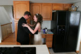 Father Terence Andre (cq) practices dancing in the kitchen with his daughter Jennifer Andre (cq),...