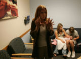 Local Denver professional photographer Debi Tipton explains to family members about her style of...