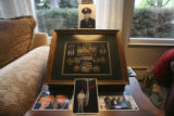 The exceptionally well decorated veteran in his military photo above some of his medals, which his...