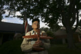 Fred Jeffers, with a model of his B-24 airplane, is a native american world war II and korea...