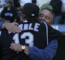 [JOE1015] Colorado Rockies general manager Dan O'dowd, right, hugs manager Clint Hurdle after the...