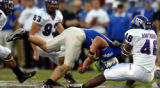 Air Force in action against TCU linebacker David Hawthorne (46) sacks Shaun Carney (5) Thursday...