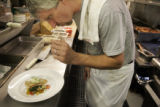 Amavi chef David Sellers (cq) prepares California White Sea Bass with Remoulade Sauce, Grilled...