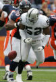 [JOE0507] Denver Broncos Montrae Holland, #70, strips the ball from  Oakland Raiders Kirk Morrison...