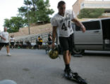 CU linebacker Jordan Dizon takes off his cleats before entering the University of Colorado's  new...