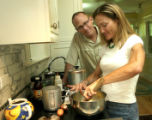 Deborah Baker (cq) right, and husband, Barry Swartz, in their kitchen of their home on Ash Street,...
