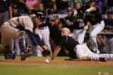 [JOE1556]  San Diego Padres catcher Michael Barrett, right, reaches for the ball near home plate...