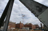 A crane on a construction site on 1401 Wynkoop street, rises up over the downtown Denver skyline...