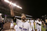 DM4874 Todd Helton celebrates on the field after the Rockies 9-8 victory in 13 innings.  Colorado...