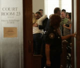 Frank Bingham gets a hug in Judge Morris Hoffman's courtroom after he sentenced Larry Trujillo to...