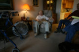 Ralph McClelland, (cq), 91, laughs with his friend and hospice volunteer Mike Davis, at his home...