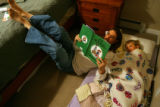 MJM155  Dr. Jeremiah Eckhaus (cq) reads a bedtime story his daughter, Eliana Eckhaus, 3, at their...