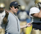 SPECIAL TO THE ROCKY MOUNTAIN NEWS - University of Akron football coach J.D. Brookhart oversees...
