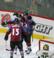 Andrew Brunette, and Jaroslav Hlinka celebrate with Paul Stasny, right, after his third goal in...
