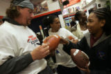 Broncos football player #66 Tom Nalen signs one of three footballs for Jelsea Ford (cq), 13, at...