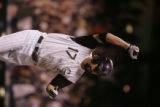 [ES108] -Colorado Rockies first basemen Todd Helton rounds the bases after his two run home run in...