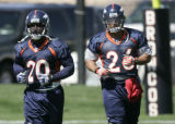 0036 Denver Broncos running backs Travis Henry, left, and Pall Smith jog during practice at Dove...