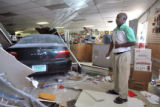 Abai Yihdego (cq), owner of the Syracuse Market at 1131 Syracuse Street grimaces in pain after a...