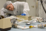 DLM1290  Systems engineering manager Terrance Yee tests the electrical components of a future...