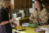 Writer Pam Houston, right, makes lunch at her ranch in Creede, Co. on Friday Sept. 14, 2007, with...