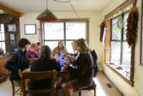 Writer Pam Houston, center, has lunch at her ranch in Creede, Co. on Friday Sept. 14, 2007, with...