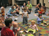 "Parents and their children take part in a program called ""Book Babies"", September 13,..."