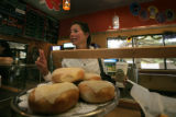 Lorene Wrapp (cq) of Boulder orders two bagels at Moe's Bagel in Boulder, Colo. Wednesday, October...