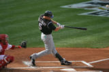 [ES0011] Colorado Rockies left fielder Matt Holliday blasts a back to back home run after one hit...