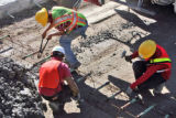 Crews repave a section of South  Federal near Louisiana Street, originally paved in 1958, on ...